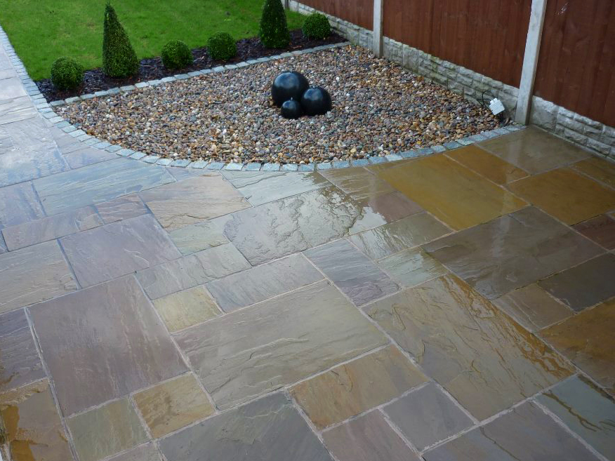 York Green Natural Paving With Water Feature, Ambient Outdoor Lighting And  Raised Decked Area With